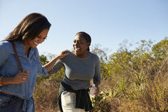 Mother And Adult Daughter Hiking Outdoors In Countryside royalty free stock photos