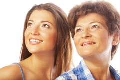 Mother and adult daughter looking up Stock Images