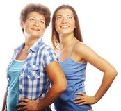 Mother and adult daughter looking up Royalty Free Stock Photos