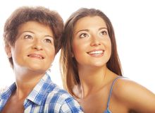 Mother and adult daughter looking up Stock Photo