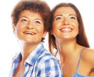 Mother and adult daughter looking up Stock Image