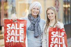 Mother And Adult Daughter In Shopping Mall Together Royalty Free Stock Photo