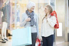 Mother And Adult Daughter In Shopping Mall Together Royalty Free Stock Image