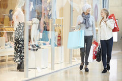 Mother And Adult Daughter In Shopping Mall Together Stock Photography
