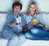 Mother with adult daughter watching television Royalty Free Stock Image