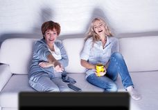 Women looking film comedy Stock Photo