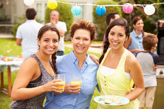 Mother With Adult Daughters Enjoying Party In Garden Royalty Free Stock Images