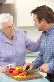 Mother and adult son preparing meal together Stock Photo