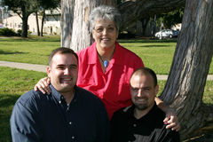 Mother and adult sons. Happy Caucasian mother and adult sons outside at the park Stock Photo