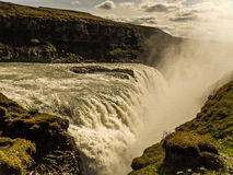 Mother of all waterfalls. Main tourist attraction in Iceland is called the Golden Triangle, stopping at this spot called golden Waterfall (Gullfoss Royalty Free Stock Photos