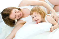 Mother An Baby In Bed Royalty Free Stock Images