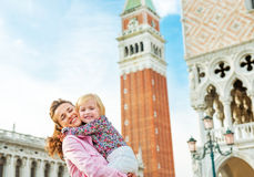 Mother And Baby Against Campanile Di San Marco Stock Images