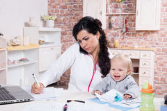 Free Mother And Baby In Home Office Stock Photography - 34385762