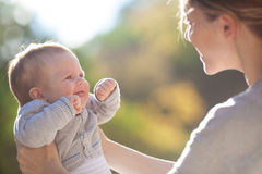 Mother And Baby In Park Portrait Stock Images