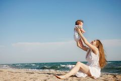 Mother And Baby On Beach Royalty Free Stock Image