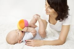 Free Mother And Baby Playing Toy Ball, New Born Kid Play With Mom Stock Images - 113982614