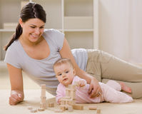 Free Mother And Baby Playing With Wooden Blocks Royalty Free Stock Photos - 6568688