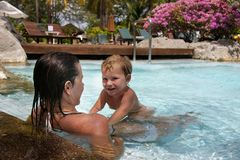 Mother And Child In Water Pool Royalty Free Stock Photos