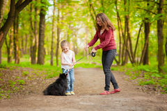 Free Mother And Child Walking Playing With Dog Stock Photo - 24732710
