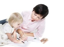Mother And Child Writing Over White Stock Images