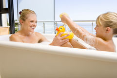 Free Mother And Daughter (6-8) In Bath Outdoors, Woman With Rubber Duck, Smiling At Each Other Stock Images - 41722734