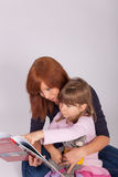 Mother And Daughter Are Reading A Book Royalty Free Stock Photos