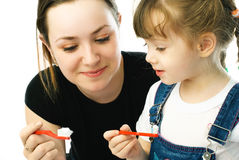 Mother And Daughter Brushing Teeth Royalty Free Stock Images