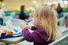 Mother And Daughter Dinning Fast Food Meal In Mall Royalty Free Stock Image
