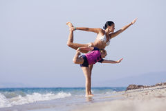 Mother And Daughter Doing Joga Royalty Free Stock Image