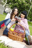 Mother And Daughter Drinking Wine Outdoors Royalty Free Stock Photo