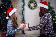 Mother And Daughter Holding Christmas Gift Stock Images