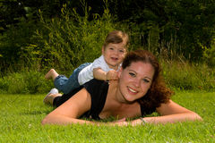 Mother And Daughter In The Grass Royalty Free Stock Images