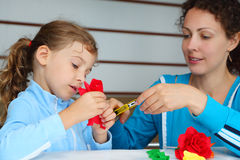 Mother And Daughter Make Artificial Roses Royalty Free Stock Photos