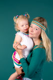 Mother And Daughter On A Turquoise Background Stock Photography