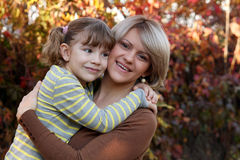 Free Mother And Daughter Portrait In Autumn Park Royalty Free Stock Photo - 33407935