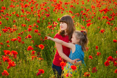 Free Mother And Daughter Smiling In A Poppy Field. The Picnic In The Poppy Field. Walk With Family In Poppy Field. The Cart Poppies Stock Photo - 91838080