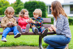 Mother And Her Children In Summer Park Royalty Free Stock Images