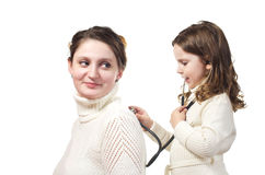 Mother And Her Little Doctor. Stock Photo