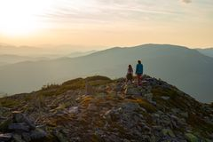 Mother And Her Teenage Daughter Are Standing On A Stony Ridge Royalty Free Stock Photo