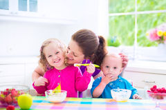 Mother And Kids Having Breakfast Royalty Free Stock Photo