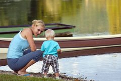 Mother And Son By The River Stock Images