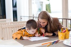 Free Mother And Son Draw Drawing Hands Colored Pencils Royalty Free Stock Images - 108095669