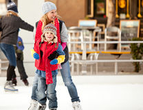 Mother And Son On Ice Stock Photo