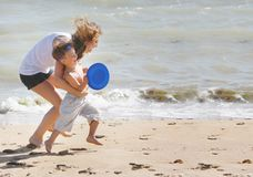 Mother And Son Playing On Beach Stock Photography