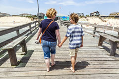 Mother And Son Walking Hand In Hand Stock Photo