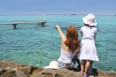 Mother ans daughter tourist formentera turquoise Royalty Free Stock Photos
