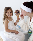 Mother applying blusher with her daughter Royalty Free Stock Photo