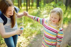 Free Mother Applying Insect Repellent To Her Daughter Before Forest Hike Summer Day. Protecting Children From Biting Insects At Summer Stock Photography - 176478722