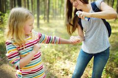 Free Mother Applying Insect Repellent To Her Daughter Before Forest Hike Summer Day. Protecting Children From Biting Insects At Summer Stock Images - 176479084
