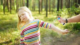 Free Mother Applying Insect Repellent To Her Daughter Before Forest Hike Summer Day. Protecting Children From Biting Insects At Summer Stock Photos - 176479243